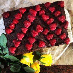 Raspberry cake with chocolate chips and frosting